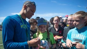 Sprint star Andre De Grasse of Markham finally learns that he's a hero to kids. CP Photo.