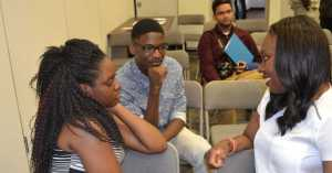 Mitzie Hunter, right, at the recent UMOVE and Zero Gun Violence Parents Conference. Photo by Gerald V. Paul.