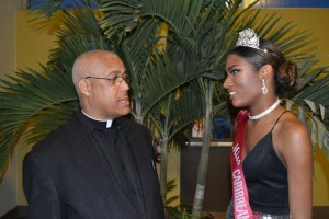 Rev. Fr. C. Guiseppi, pastor and director of Our Lady of Good Counsel Caribbean-Canadian Roman Catholic Church chats with Desley Andrew-Augustin, Miss Caribbean Canada 2015, who received a scholarship in 2013. Gerald V. Paul photo.