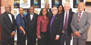 (From left) Haynesley Benn, Consul General of Barbados in Toronto, Lydia  and Alvin Jemmott, ,Angela Allman-Fenty and Bishop Peter Fenty, Johm McCallum, Canada's  Immigration Minister and Sir Phillips Greaves. (In back row) Wendy  and Mark Beckles,
