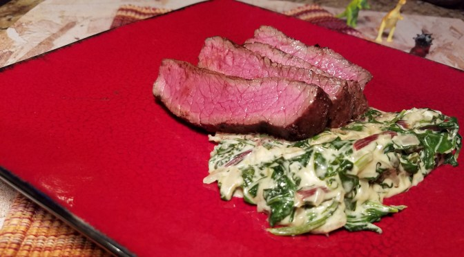 Cocoa-Ancho Rubbed Steaks with Creamy Parmesan Greens