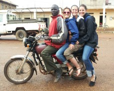 Becca, Sarah and Dana on a Boda Boda. Sometimes I'd see 5 or 6 people riding on one Boda.