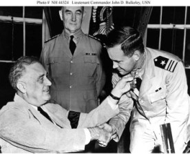 Receives the Medal of Honor from President Franklin D. Roosevelt, circa July 1942. Bulkeley was awarded the medal for heroism while he commanded Motor Torpedo Boat Squadron Three during the Philippines Campaign, December 1941 - April 1942. U.S. Naval Historical Center Photograph.