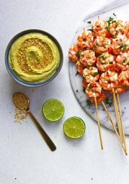 Edamame, miso, ginger and lime dip with zesty garlic, ginger and chilli prawn skewers