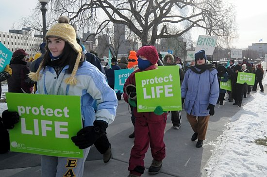 Pro-life supporters marched in below-zero temperatures around the state Capitol grounds Jan. 22 during Minnesota Citizens Concerned for Life's annual March for Life and rally on the Capitol steps in St. Paul. The event began with an ecumenical prayer service at the Cathedral of St. Paul. During the service, Bishop Lee Piché recognized the many teenagers and young adults present and thanked them for giving hope to the future of the pro-life movement. Afterward, many braved the cold to march to the Capitol while others stayed to pray at the Cathedral. (Dianne Towalski/The Catholic Spirit)