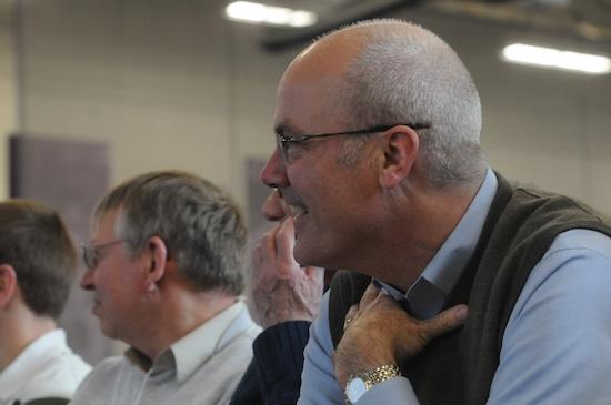 Scott Hussen, a member of St. Hubert in Chanhassen, laughed during Glenn Caruso's talk.
