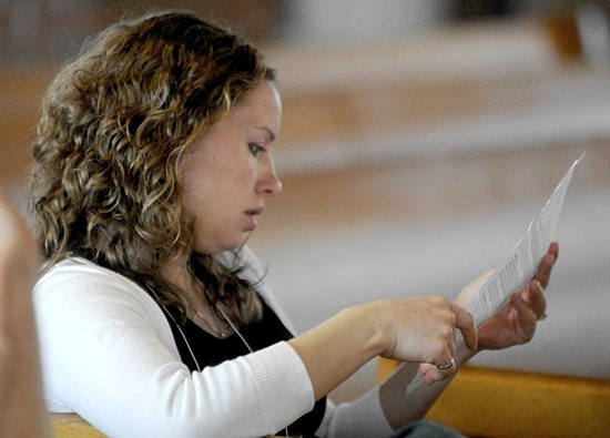 Above, Chrissy Klocker from St. Peter in North St. Paul participates in the Mass.