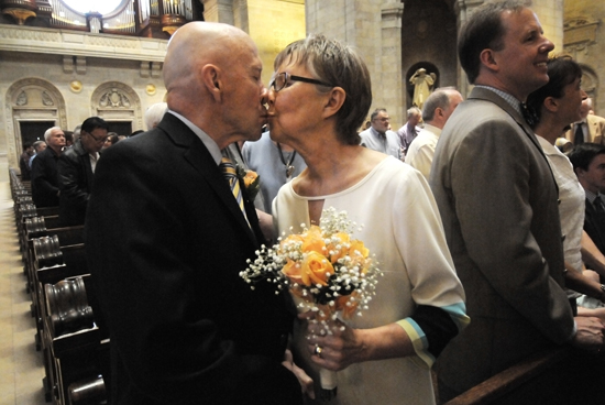 """Denny and Judy O'Hagan, members of St. Mary of the Lake in Plymouth, shared a kiss after renewing their marriage vows during the Mass. The O'Hagans have been married 50 years. """"He makes me laugh,"""" Judy said when asked the secret to a good marriage. """"A lot of humor and wonderful children and grandchildren,"""" Denny added."""