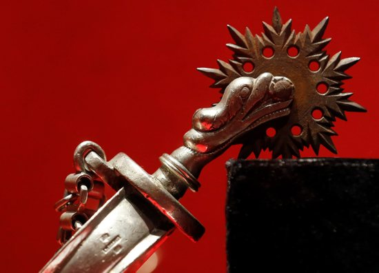 "A spur used by gauchos is seen in the Vatican exhibit ""Argentina, the Gaucho: Tradition, Art and Faith,"" which runs until June 16. CNS photo/Stefano Rellandini, Reuters"