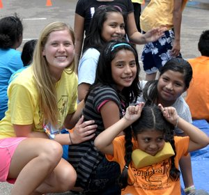 "Vacation Bible School students at Immaculate Heart of Mary in Houston, Miss., enjoy water games in the heat during ""Water Wednesday,"" July 10. In yellow shirt at left is volunteer Alicia Gruenwald, a member of St. John the Baptist in Savage. Photo by Kathy Lerick"