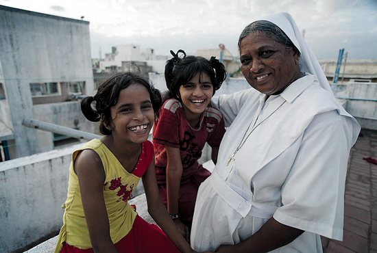 Vandoosha, center, and her friend Shorti were rescued from child trafficking by Sister Clara and the Salesian Sisters at Marialay Children's Home in Chennai, India.  Photo courtesy of The Society for the Propagation of the Faith