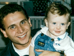 Bishop Cozzens holds his nephew, Sean Healy, in a photo taken 17 years ago. Photo courtesy of Judy Cozzens
