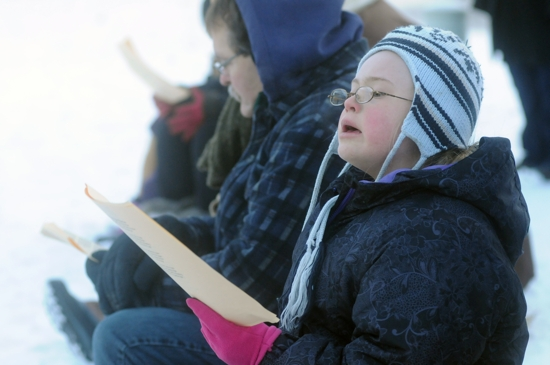 Eleven-year-old Helen Lane, a member of St. Nicholas in New Market, sings along during the event.