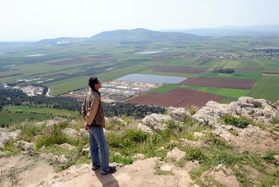 A man looks out over the Jazreel Valley from Mount Precipice in Nazareth, Israel. The hill, believed to be where Jesus was led to after being rejected in Nazareth (Luke 4: 29-30), is the start of the new Gospel Trail.  CNS photo/Debbie Hill
