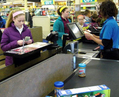More than 100 seventh- and eighth-grade students from St. Hubert School in Chanhassen spent March 12 at Cub Foods purchasing items to donate to People Reaching Out to Other People, a local food shelf and multi-service organization serving the Chanhassen and Eden Prairie area.  The project is a part of St. Hubert's larger social justice curriculum. The students partnered with People Reaching Out to Other People to better understand food costs and how providing food for a family impacts people with no or limited incomes. The students had to earn the money themselves outside of school and try to stretch their $10 to $20 budget by finding coupons.