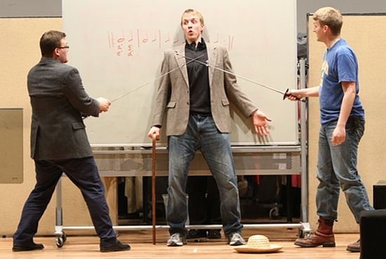 "From left: Seminarians Andrew Thuringer, Benjamin Wittnebel and Jeffrey Baustian of the St. Paul Seminary rehearse a scene from the play, ""Murder and Mariolatry,"" an adaptation of G.K. Chesterton's novel, ""The Ball and the Cross."" The play was written and produced by another seminarian, Kyle Kowalczyk.  Dave Hrbacek / The Catholic Spirit"