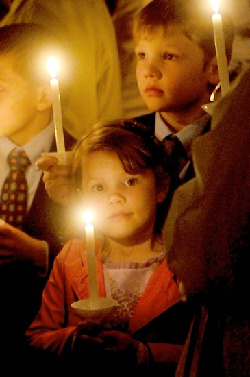 Children carry candles lit from the Easter candle in procession at the start of the Easter Vigil at the Cathedral of St. Paul. Dianne Towalski/The Catholic Spirit
