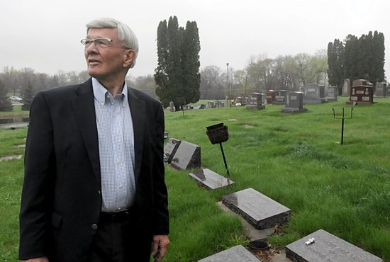 Bob Labat visits Holy Name of Jesus Cemetery in Wayzata May 12. Four of his children are buried there with the graves in the shape of a cross. Dianne Towalski/The Catholic Spirit