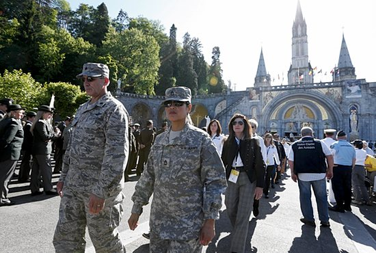 WOUNDED WARRIORS U.S. military personnel walk in procession during a pilgrimage at the Shrine of Our Lady of Lourdes in southwestern France May 16. About 60 wounded U.S. military personnel, together with family members and caregivers, were a part of the annual Internatio nal Military Pilgrimage to Lourdes. Read more on page 10B. CNS photo/Paul Haring