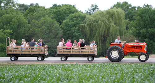 Dan Rosckes, son of Vernon and Elaine Rosckes, takes folks on a tractor ride. Dave Hrbacek/The Catholic Spirit