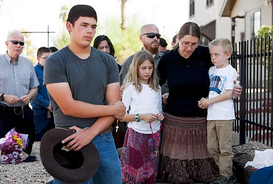 PRIEST ATTACK Parishioners, including Jennifer Gustke, right, with her children, pray the rosary near Mater Misericordiae (Mother of Mercy) Mission in Phoenix the morning after a priest was killed and another critically injured during an attack at the mission's rectory the night before. Sgt. Steve Martos of the Phoenix Police Department said police received a 911 call at about 9 p.m. June 11 reporting a burglary. Read more on page 11. CNS photo/Nancy Wiechec