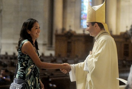 Alma Valle Miranda of St. Stephen in Anoka greets Bishop Cozzens as she comes forward to receive her diploma from the Leadership Institute.