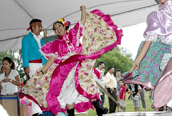 Dancers perform at Latino Family Day Aug. 2 at Como Park in St. Paul. The annual event, sponsored by the Archdiocese of St. Paul and Minneapolis' Office of Latino Ministry, kicked off with Mass celebrated by Bishop Andrew Cozzens, along with other priests, including Father Kevin Kenney, pastor of Our Lady of Guadalupe in St. Paul and vicar for Latino Ministry in the archdiocese. Later, Bishop Cozzens gave a special blessing to Latino youth.  José Condor/For The Catholic Spirit