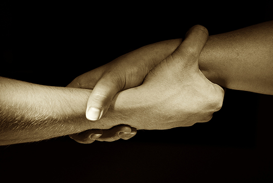 Hands Unite With Eachother As Friends Greeting