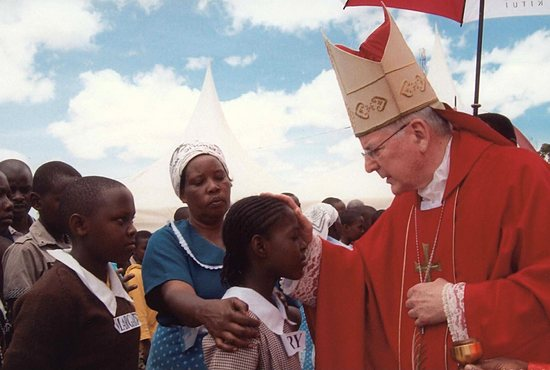 Archbishop John Nienstedt confirms a candidate Oct. 12 in Kitui, Kenya, as part of a delegation from the Archdiocese of St. Paul and Minneapolis to celebrate the 10-year anniversary of the partnership with the Diocese of Kitui. Photo courtesy of Archbishop John Nienstedt