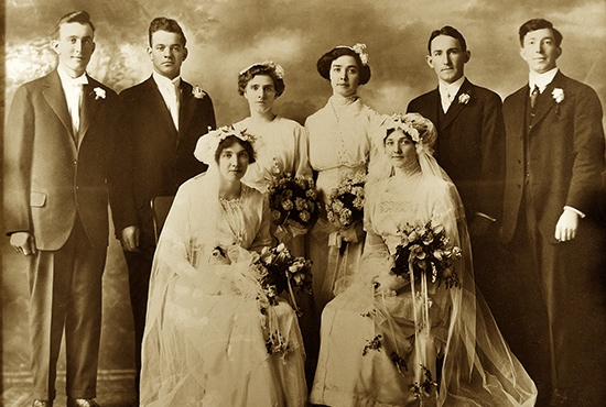 "Sisters Winifred and Catherine O'Dowd were the brides in the first double wedding celebrated in the then ""new"" Cathedral of St. Paul April 14, 1915. Winifred married Joseph Jolly; Catherine wed Gerald Fenlon. The photo of the wedding parties will be first in line in the Cathedral Centennial Wedding Exhibit that will go on display June 6, 2015. The cathedral is continuing to solicit photos of those married at the cathedral as part of the 100th anniversary of the first Mass and simple dedication in 1915."