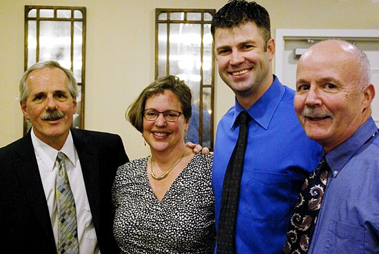 WINTER GALA Scott Sherman (from left); Laurie Sherman, principal of St. Jerome School in Maplewood; Jake Mauer and Terry McEvoy attend St. Jerome's first Winter Gala Dec. 14 at Manitou Station in White Bear Lake. Mauer, a former Minor League Baseball player with the Minnesota Twins and alum of St. Paul schools Cretin-Derham Hall and the University of St. Thomas, was the featured speaker. The parish in Maplewood hosted the gala to raise money for tuition assistance for students at the parish school. Archbishop John Nienstedt attended to bless the meal and attendees. Submitted photo