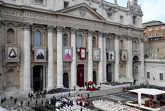 SIX NEW SAINTS The banners of six new saints hang from the facade of St. Peter's Basilica as Pope Francis celebrates their canonization Mass in St. Peter's Square at the Vatican Nov. 24. From left are: Euphrasia Eluvathingal, an Indian Carmelite sister and member of the Syro-Malabar Catholic Church; Ludovico of Casoria, an Italian Franciscan priest who founded the Grey Franciscan Friars of Charity and the Grey Franciscan Sisters of St. Elizabeth; Giovanni Antonio Farina, an Italian bishop of Vicenza and the founder of the Teaching Sisters of St. Dorothy; Kuriakose Elias Chavara, the Indian founder of the Carmelites of Mary Immaculate, a Syro-Malabar Catholic order; Nicholas of Longobardi, an Italian friar of the Minim order; and Amato Ronconi, a 13th-century Italian lay Franciscan and founder of a hospice for the poor, which is now a home for the elderly in Rimini, Italy. CNS/Paul Haring