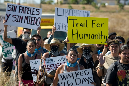Participants in the Trail for Humanity pro-immigrant rights caravan protest in front of the U.S. Border Patrol station in Murrieta, Calif., Aug. 15. There is a new initiative by leaders of U.S. Catholic colleges and universities supporting humanitarian actions for minors coming across the U.S.-Mexico border. CNS photo/David Maung, EPA