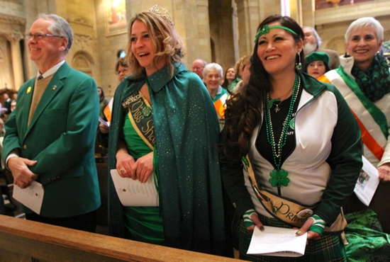 "From left, Mike McGinn, Shellie Pearson and Jennifer Renwick react to some humor from Bishop Lee Piché during Mass to celebrate St. Patrick's Day March 17 at the Cathedral of St. Paul. McGinn, a former St. Paul Police commander, is ""Mr. Pat,"" the Irish King of St. Paul, and Pearson is ""Miss Shamrock,"" the Irish Queen crowned by the St. Patrick's Association. Dave Hrbacek/The Catholic Spirit"