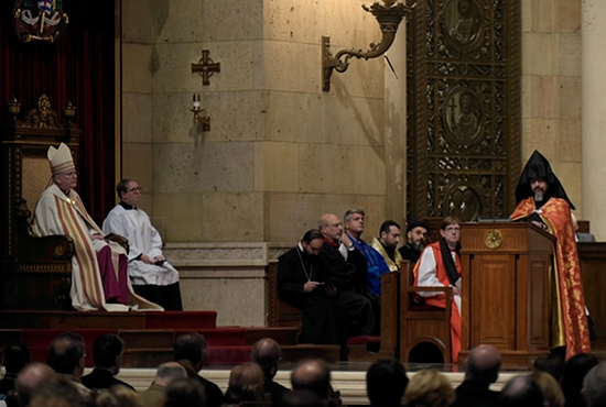 Father Aren Jebejian, pastor of St. Gregory the Illuminator Armenian Church in Chicago, speaks at the Cathedral of St. Paul during an ecumenical prayer service commemorating the 100th anniversary of the Armenian massacres April 18, as Archbishop John Nienstedt and Father Erich Rutten (far left) look on.  Jim Bovin/For The Catholic Spirit
