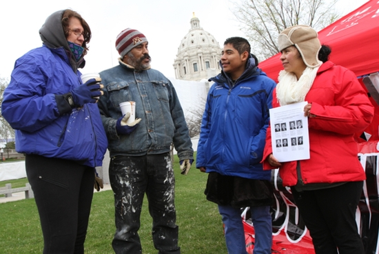From left, Nancy Schroedsen, Ruben Urrutia, Julio Martinez and Antonia Alvarez talk during a vigil in front of the State Capitol to promote legislation to allow immigrants living in this country who are not yet citizens to obtain a driver's license. The vigil was scheduled to go until 10 a.m. April 22, with planned visits to state legislators to lobby for passage of the HF-97 driver's license bill. Alvarez and Martinez belong to Sagrado Corazon de Jesus (Incarnation) in Minneapolis. Dave Hrbacek/The Catholic Spirit