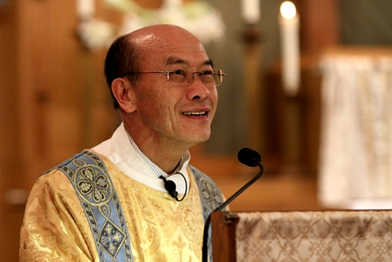 Deacon Nao Kao Yang talks to the congregation during Mass. Photos by Dave Hrbacek/The Catholic Spirit