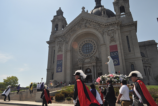 Members of the Knights of Columbus color guard carry a statue of Mary to the Cathedral of St. Paul May 3. The statue led a procession of hundreds of Catholics from the Minnesota State Capitol to the Cathedral. Maria Wiering / The Catholic Spirit