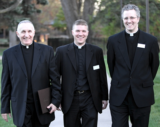 Deacon James Stiles, center, walks to the main building at the St. Paul Seminary with Msgr. Aloysius Callaghan, rector of the seminary, and Father Scott Carl, a faculty member. Dave Hrbacek/The Catholic Spirit