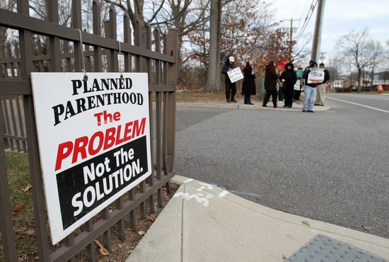 Pro-life advocates participate in a prayer vigil in January near the entrance to a Planned Parenthood clinic in Smithtown, N.Y., that performs abortions. An AP survey shows that the number of abortions has declined in most states. CNS photo/Gregory A. S hemitz