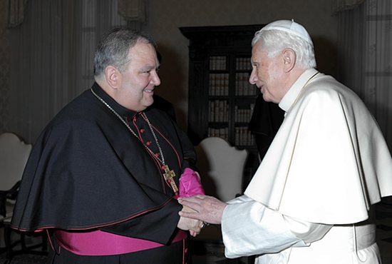 Pope Benedict XVI greets Bishop Bernard Hebda during a Feb. 3, 2013, meeting with U.S. bishops from Michigan on their ad limina visits to the Vatican. Then bishop of Gaylord, Archbishop Hebda was named apostolic administrator of the Archdiocese of St. Paul and Minneapolis June 15. CNS file photo