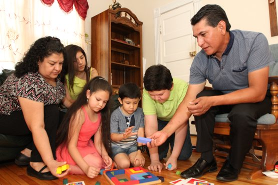 From left, Maria, Jimena, Mariana, Santiago, Josue and Patricio Pena play a game in the living room of their home in south Minneapolis. They belong to Sagrado Corazon de Jesus in south Minneapolis. Dave Hrbacek/The Catholic Spirit