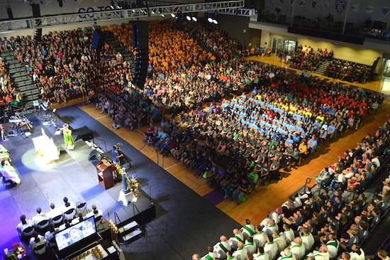 Nearly 2,000 young people fill Schoenecker Arena on the St. Paul, Minnesota, campus of the University of St. Thomas for the closing Mass of the Steubenville North youth conference, held July 24-26. Bishop Andrew Cozzens was the principal celebrant.