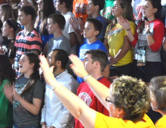 Young people pray at the Steubenville North youth conference July 26 on the St. Paul, Minnesota, campus of the University of St. Thomas.
