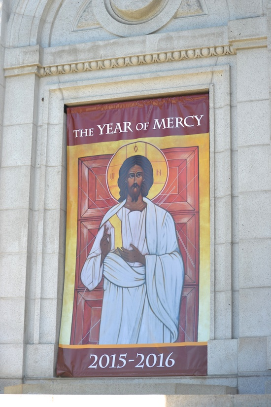 The holy door at the Basilica of St. Mary in Minneapolis is covered with a picture of the Divine Mercy icon — the face of Christ. The door will be closed for the next three months and opened during Mass on Dec. 13 for the beginning of the Year of Mercy.