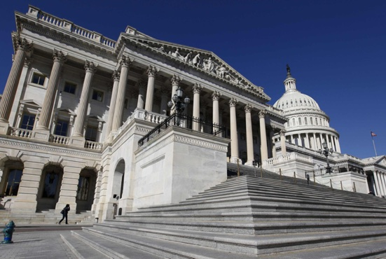 The U.S. Capitol dome is seen behind the entrance to the House of Representatives on Capitol Hill in Washington. During his Sept. 22-27 visit to the United States, Pope Francis will address a joint meeting of Congress Sept. 24, becoming the first pope to do so. CNS /Larry Downing, Reuters