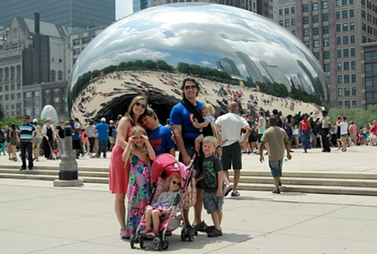 The Davis family stops for a photo at the Cloud Gate in Millennium Park on a recent trip to Chicago. Jenny and Casey are pictured with their five children: Peter, 10; Charlotte, 7; Jameson, 5; Stella, 3, and Bridget, 1. Courtesy the Davises