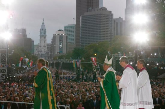 Pope Francis leaves in procession after celebrating the closing Mass of the VIII World Meeting of Families on Benjamin Franklin Parkway in Philadelphia Sept. 27. CNS photo/Paul Haring)