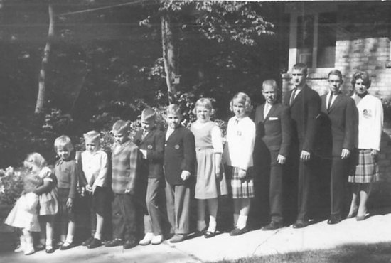 The 13 children of George and Evelyn Sayer line up in this photo circa 1960. Before his death, George set up a charitable foundation that his family continues to operate with help from the Catholic Community Foundation, ensuring their investments are in line with their Catholic values. Courtesy Ginny Metzger