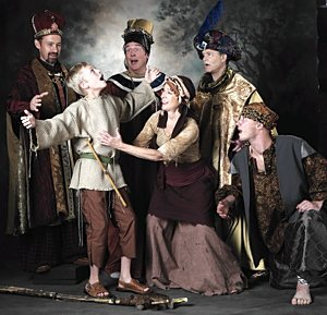 "From left, Christopher Fast (King Melchoir), Vincent VanHatten (Amahl), Rich Kubista (King Balthazar), Peg Janisch (Amahl's mother), Andy Elfenbein (King Kasper) and, kneeling, Joshua Vosberg (the page) in a scene from ""Amahl and the Night Visitors."" Courtesy Joe McDonald"